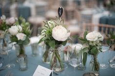 small jars of flowers for table idea