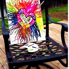 Crayon art. (for the middle of the canvas, I hot-glued crayons to a paper plate, then melted each color separately with a heat gun to create dots in the center of the 2 hearts :)