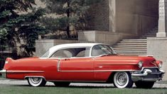 You'll never lose in a parking lot! This bright red 1956 Cadillac Coupe DeVille is a head-turner everywhere it goes.