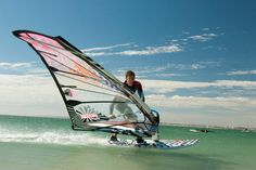 windsurfing. Tried it in Florida, couldnt use my arms for a day. Surfing was so much easier for me.