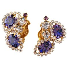 For Sale on - Absolutely gorgeous sparkling rhinestone earrings from the mid-century era, featuring faceted purple crystal rhinestones surrounded by clear crystal rhinestone Rhinestone Earrings, Vintage Rhinestone, Vintage Earrings, Crystal Earrings, Crystal Rhinestone, Clip On Earrings, Dangle Earrings, Blue Topaz Diamond, Vintage Diamond