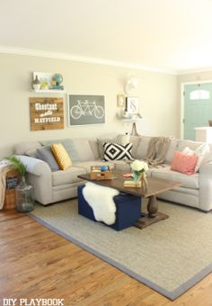 Affordable HomeGoods accessories & pillows help brighten this cozy space! #HomeGoodsHappy #sponsored
