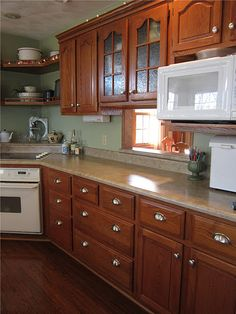 Revive an old kitchen counter top with Rustoleum Counter Top Coating. Read for full details ...