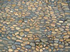 Como pavimentar usando pedras de rio e argamassa