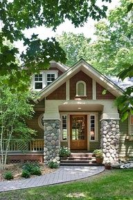 Great craftsman style house, love the stone columns