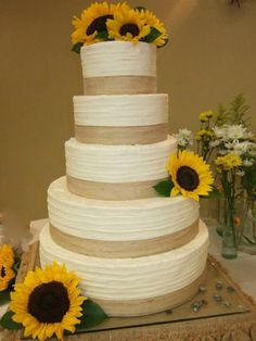 Rustic charm!  Rustic Wedding cake with Sunflowers...I made this for a friend!