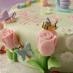 A rose garden themed birthday cake for a little girl named Rose.