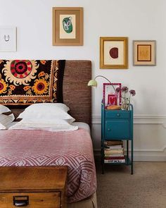 casual decor like the idea of a solid-colored upholstered headboard with change-able patterned throw over it-h
