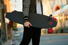Is this the future of skateboarding? An electric monolith skateboard features motors in the wheels.
