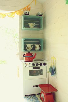 .How sweet is this little play kitchen area?   Love the vintage (NOT plastic) touch!