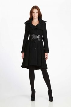 Black trenchcoat....thats cute and powerful enough to make a statement without being shouty....yes