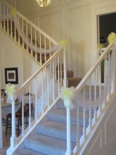 Tulle decorations on the stairs for the wedding