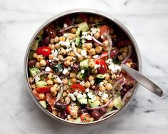 Chickpea Greek Salad Recipe Salads with lemon, olive oil, salt, black pepper, chickpeas, cherry tomatoes, purple onion, cucumber, pitted kalamata olives, feta cheese crumbles, chopped parsley