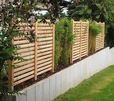 Garden fence made of Douglas fir wood on natural stone wall - Country Fences, Natural Stone Wall, Diy Planter Box, Pergola Curtains, Pergola Attached To House, House Front Design, Garden Fencing, Outdoor Projects, Outdoor Fun