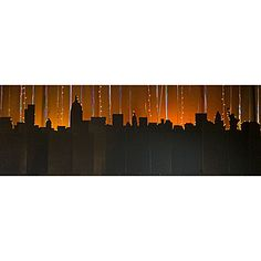 This New York Background will give your city event a stunning look of beauty! Each free-standing black cardboard New York City Skyline is accented with string lights.