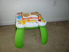 Mommy Market - Musical Table (Bilingual) - Help get your little one get off to a great start! This Leap Frog music table from Florida is jam packed with songs and activities. It's educational, fun, and teaches in both English and Spanish!