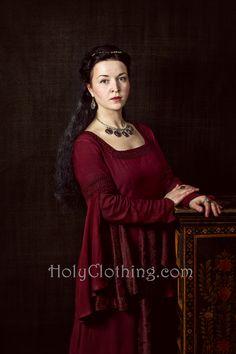 A portrait of Eugenia wearing her Burgundy Wine ARWEN dress