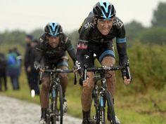 Richie Porte on the wheel of team-mate Gerraint Thomas. Stage 5 - 2014 Tour de France