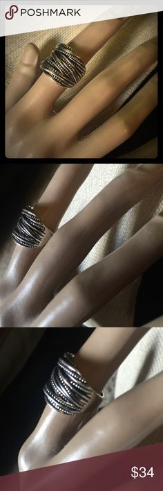 Trendy Fashion Retro Line Twine Design Ring Fashionable twined silver plated Ring. VERY CUTE! It is 3/4 inches wide across the surface. Jewelry Rings