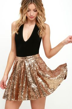 As Seen On Steffy of Steffy's Pros and Cons blog! Here at Lulus we're all raising our glasses to fashion forever and stupendous skirts like the Cheers to You! Gold Sequin Skirt! This wonderfully full skater skirt is covered in tons of glittering gold sequins from a fitted waistline to a mini skirt length. Hidden side zipper/hook clasp.