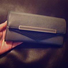 ❌BUNDLED❌ Aldo grey BOZE envelope wallet Boze grey charcoal wallet by Aldo. in excellent condition. Has magnetic snap closure. 8 cc compartments as well as 2 big compartments, one on each side for coupons, receips, papers, etc. One compartment for your licence/id and coin zipper divider. No tears or rips. ALDO Bags Wallets