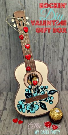 The 3D Guitar Gift Box from VINTAGE VALENTINES SVG KIT is such a fun file!  Here's Allie's super cute Guitar!  The colors and her embellishing is a perfect combination!  The strings and bow are made with hemp and the added heart buttons just bring it all together!