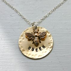 Queen bee handstamped necklace...for the queen bee in your life, even if it is yourself. (JustJaynes on Etsy)