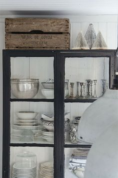 Love this cabinet—the styling is cool & love the paper Christmas trees on top. Anna Truelsen inredningsstylist