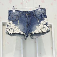 Denim stone washed and torn shorts with lace 13