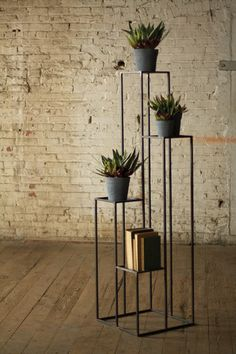 Kalalou Tall Multilevel Iron Pedestals - Multiple pedestals of varied height combine to give an elegant touch to this set of Iron Pedestals. It can be used to decorate your living room or the porch of your home.