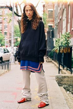 Sophie Koella in a black hoodie, vintage blue and red top, vintage track pants, and Gucci Princetown slippers