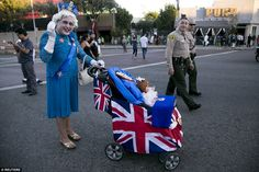 Peter Morales  dresses as Britain's Queen Elizabeth II with her grandaughter Princess Charlotte at the West Hollywood Halloween Costume Carnaval
