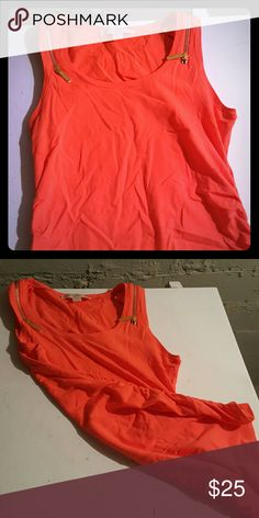 Michael kors bright orange tank NEW S New MK bright tank with gold zippers on the shoulder. Also cinched sides. Very flattering, also would look good as a maternity top. Very stretchy soft fabric. 95%cotton 5% spandex MICHAEL Michael Kors Tops Tank Tops