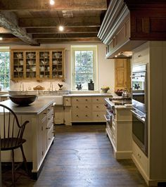 Kitchen with rustic wood flooring.