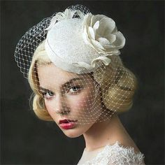 ELLA is an alluring vintage bridal headpiece