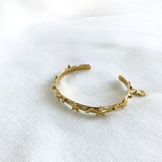 The Star Bangle brings the perfect golden flash to any outfit. This piece is gold-plated, studded with stars and adorned with subtle sparkle from. Bangles, Bracelets, Cuffs, Sparkle, Stars, Gold, Jewelry, Bangle Bracelets, Bangle Bracelets