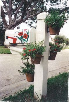 Hang clay flower pots with hangapot hangers in a spiral fashion around a mailbox post to provide a colorful accent.