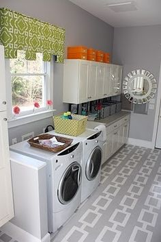 painted floor!  I even love this design for my laundry room.  I especially love the idea of painting the floor- it's an inexpensive way to style concrete floors!