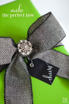 How to make the perfect bow using only one piece of ribbon to embellish gifts or to use to add to your Christmas decorations.