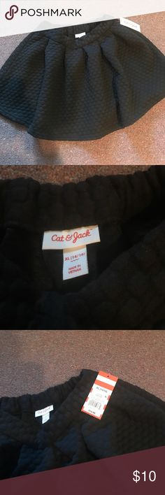 Quilted black skirt Brand new with tags- girls black skirt. It is a very soft material and has a quilt like pattern. cat & jack Bottoms Skirts