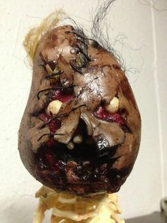 Mutilated babyface ornament by OzOtheCLown on Etsy, $30.00