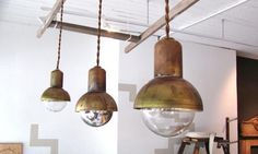 lighting fixtures:: worn brass + edison bulbs