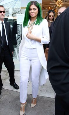 Kylie Jenner made a statement in all white everything in LA, which drew attention to her new green hair, with Caitlyn Jenner wearing a similar head-to-toe white look.