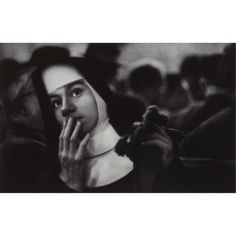 W. Eugene Smith - Andrea Doria. Nun waiting for survivors, 1956