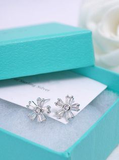 Crystal pave daisy flower post earrings with white gold by Joowel, $14.75