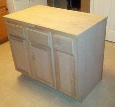 How To Make A DIY Kitchen Island And Install In Your Kitchen - Once all wood panels, wood moulding, and the top was attached, the cabinet was sanded for painting S - Kitchen Island Using Stock Cabinets, How To Install Kitchen Island, Unfinished Kitchen Cabinets, Cabinet Island, Diy Kitchen Island, Kitchen Ideas, Kitchen Updates, Kitchen Small, Kitchen Sink