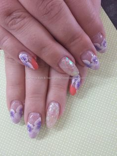 Almond nails with peach and gel polish and one stroke flower nail art