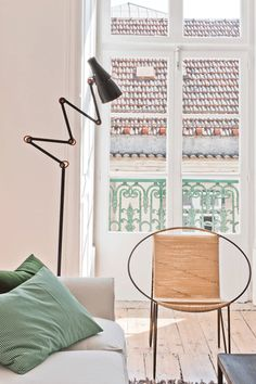 Baixa House - Serviced Apartments Rent in Lisbon ::: SAME COLORS: FLOOR,  WALLS AND ROOF TILES  -   PEACH: CHAIR AND ROOF EMBELLISHMENTS  -  SOFT GREEN: BALCONEY AND PILLOWS  -  WHITE: WINDOW AND WALL ACROSS - GREYS: COUCH, TABLE AND ROOF SLAB.