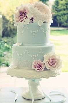 This Tiffany blue cake – with sugar roses and hydrangeas, pearl piping and lace details – is classic with a vintage touch.