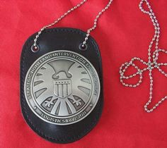 The Avengers Agents of S.H.I.E.L.D. Shield Badge with HolderChain... It would be so much fun to run around town in a suit and tie with this on over it.